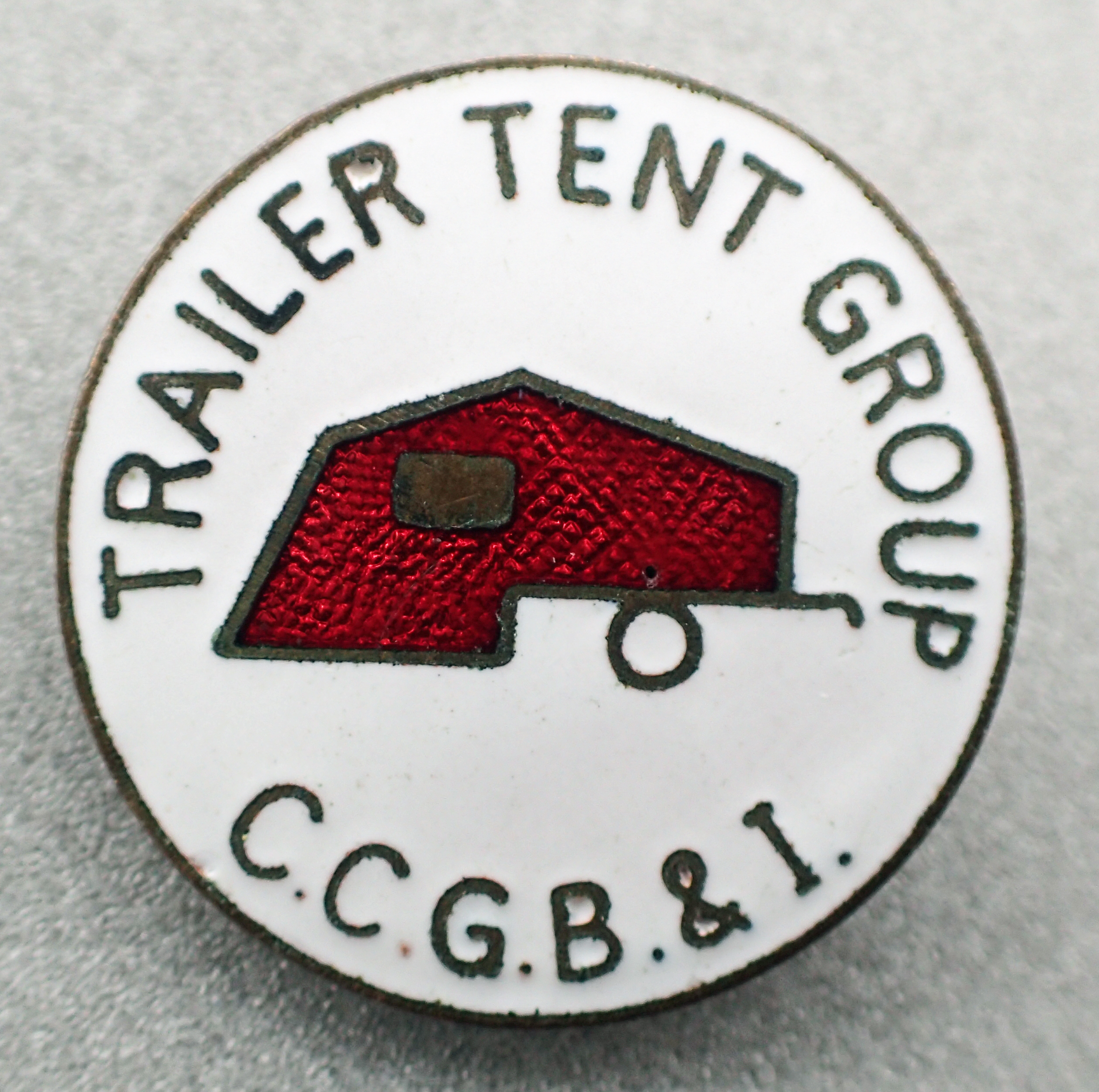 Enamel badge for members of the Trailer Tent Group- a sub-sction of the Camping and Caravanning Club of Great Britain & Ireland