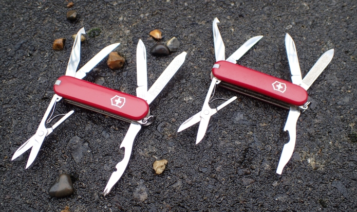 Victorinox Vagabond and Mate with tools opened
