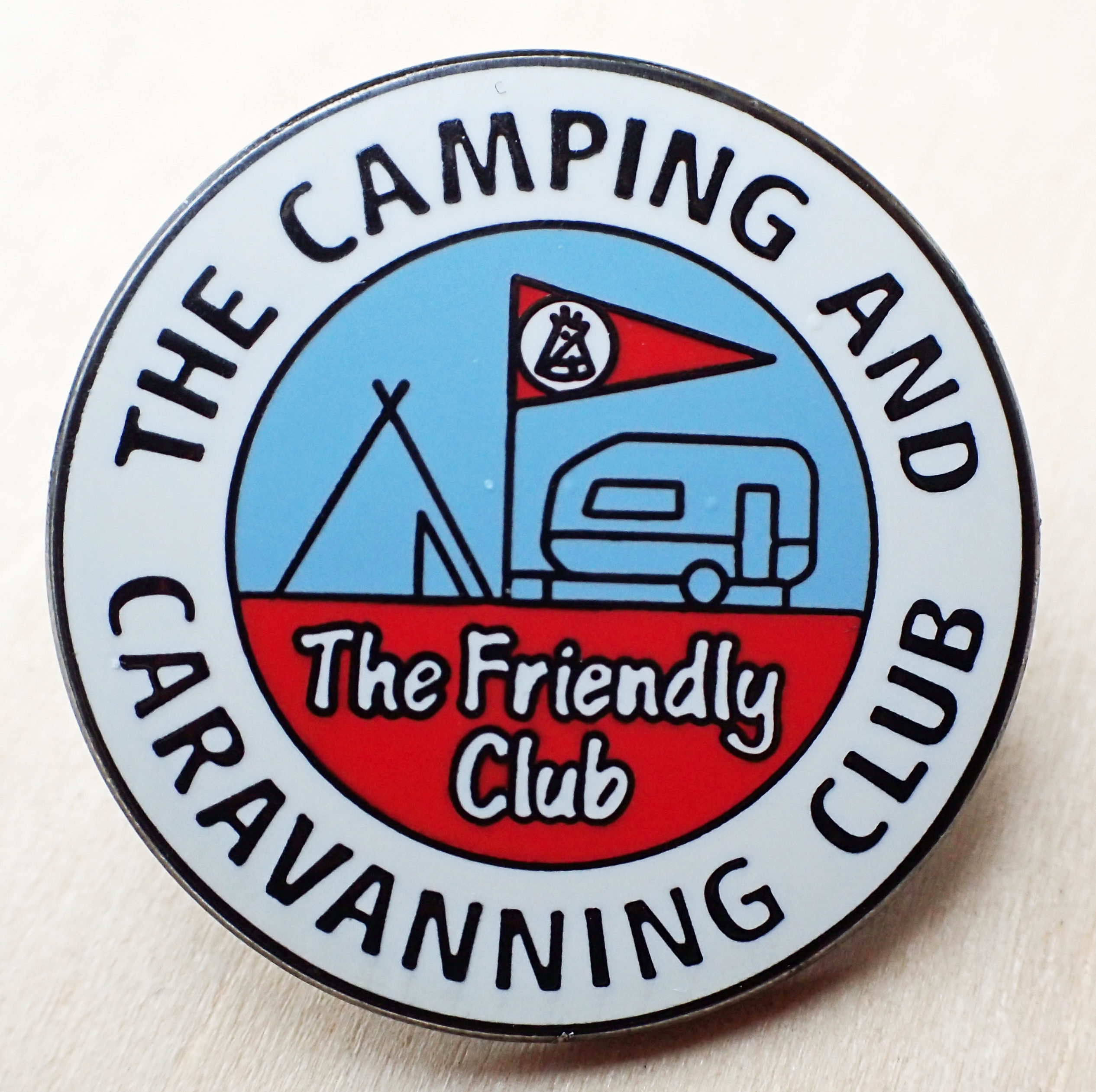 Current metal badge for The Camping and Caravanning Club