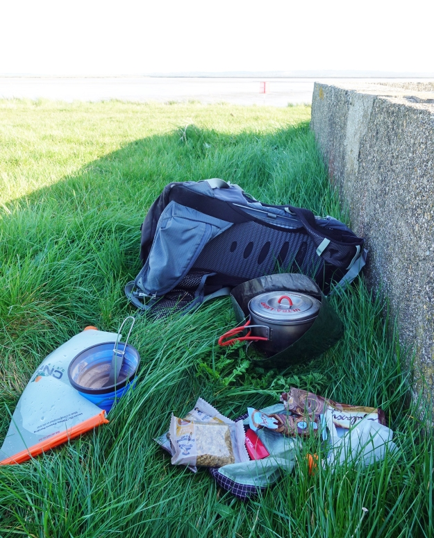 There isn't a lot of shelter from the stiff cold wind along the seawall, so I made use of one of the concrete sluices to breakfast on hot chocolate and Quaker's Golden Syrup Porridge To Go