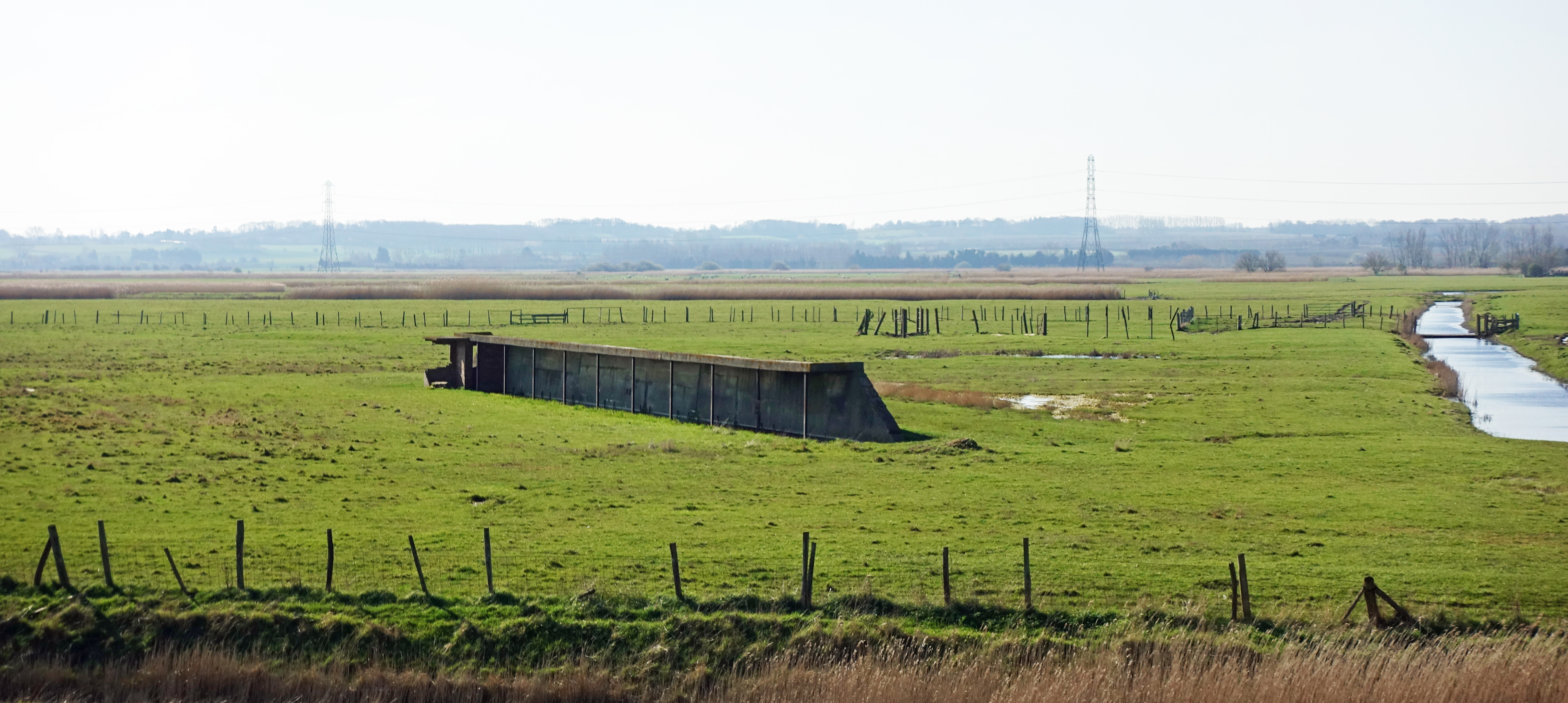 Two wartime rifle ranges are passed on this walk. The crumbling concrete butts are simply part of the grazing marsh landscape today