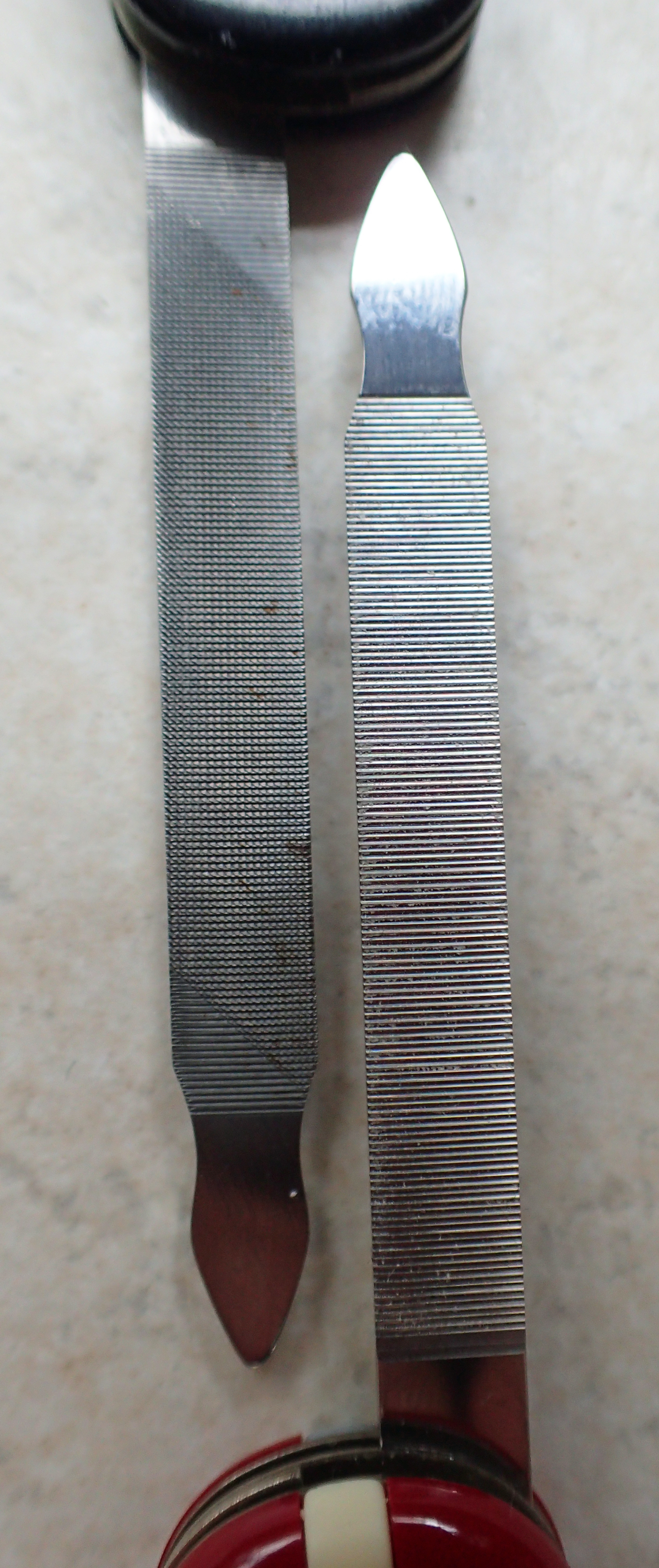 Cross, and single cut replacement, nail files on Executive compared