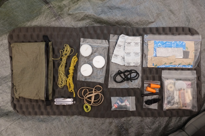 The contents of my 'ditty bag' photographed on a longer multi week hike in 2018. The contents of one small baggie here are further shown below