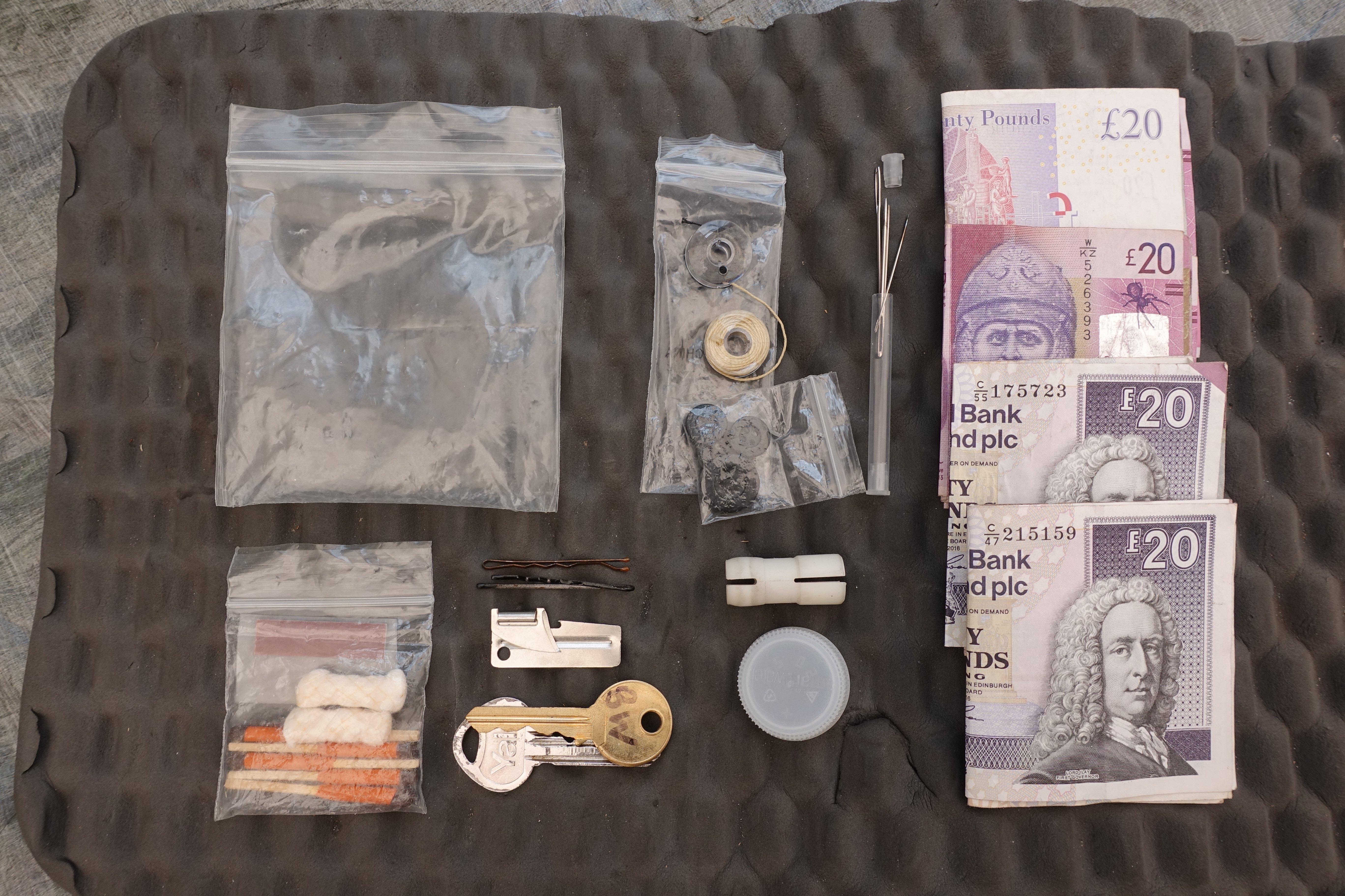 Some of the contents of my backpacking ditty bag- Money, sewing kit, house key and British Waterways water key, emergency fire starter kit, spare water bottle cap, hair grips, to be used as clothes pegs, and a small tin opener