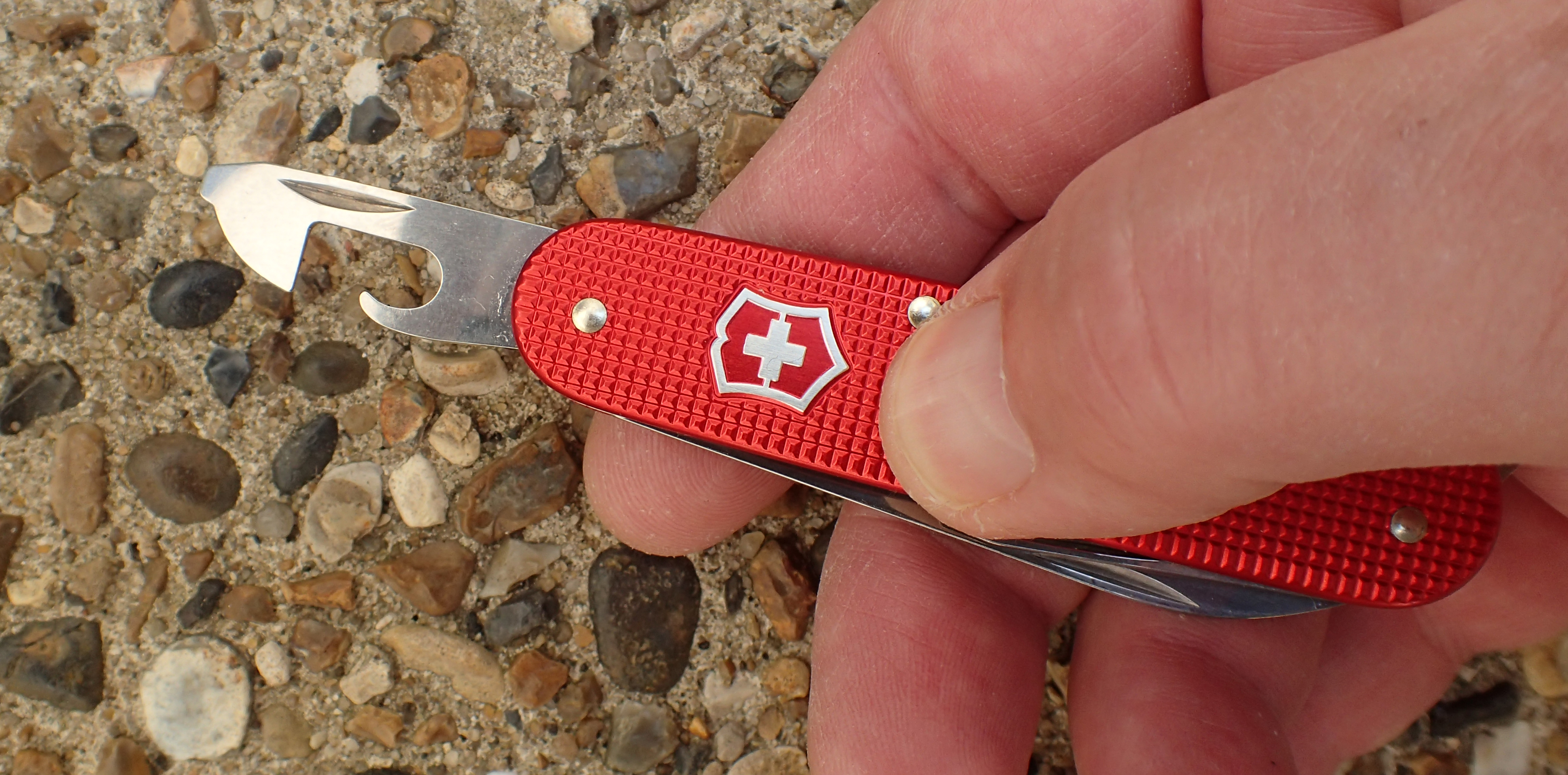 The 84mm Victorinox Alox Cadet weighs 45.9g and includes a really efficient tin opener