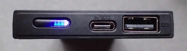 The 'business end' of NireCore NB10000. Blue LEDS show charge status, pressing and holding the mode button switches on the white LED and will then safely support charging of low current devices such as wireless headphones