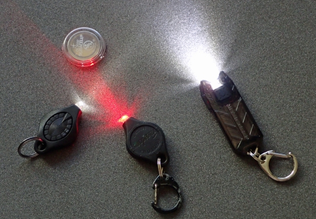 White and red LED Photon Freedom and one spare button battery weighs more than the Nitecore Tube v2