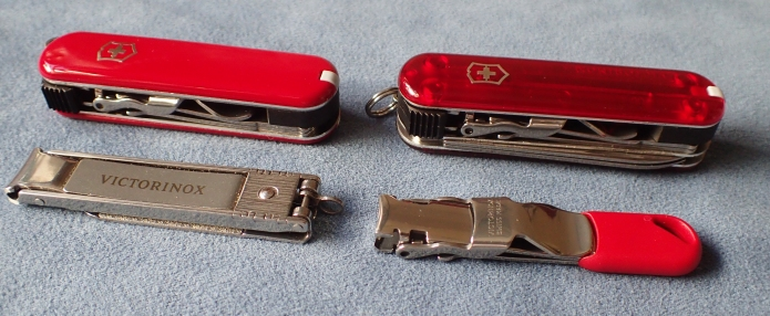 Four Victorinox nail clippers, two with traditional scales, two without