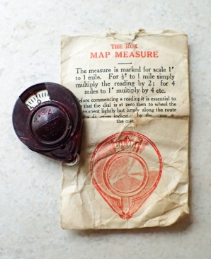 Bux map measurer in the envelope in which it was supplied