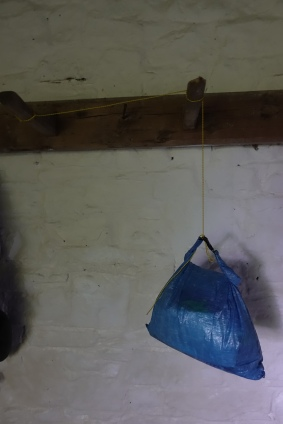 Quilt cord used to hand food bag away from rodents in bothy on South West Coast Path