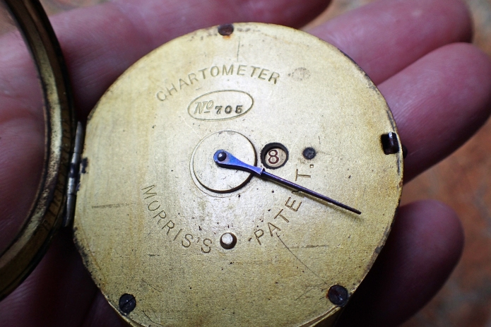 Face of Chartometer without scale card inserted. Revolution counter can be seen to the right of the hand. The lower stud protrusion ensures an inserted cart is correctly orientated