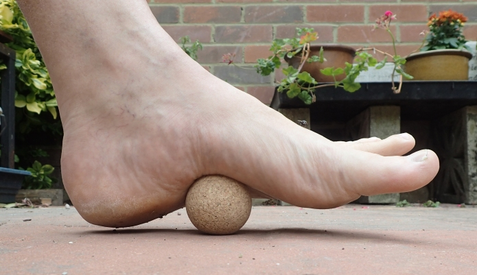 Rolling out foot on hard cork ball