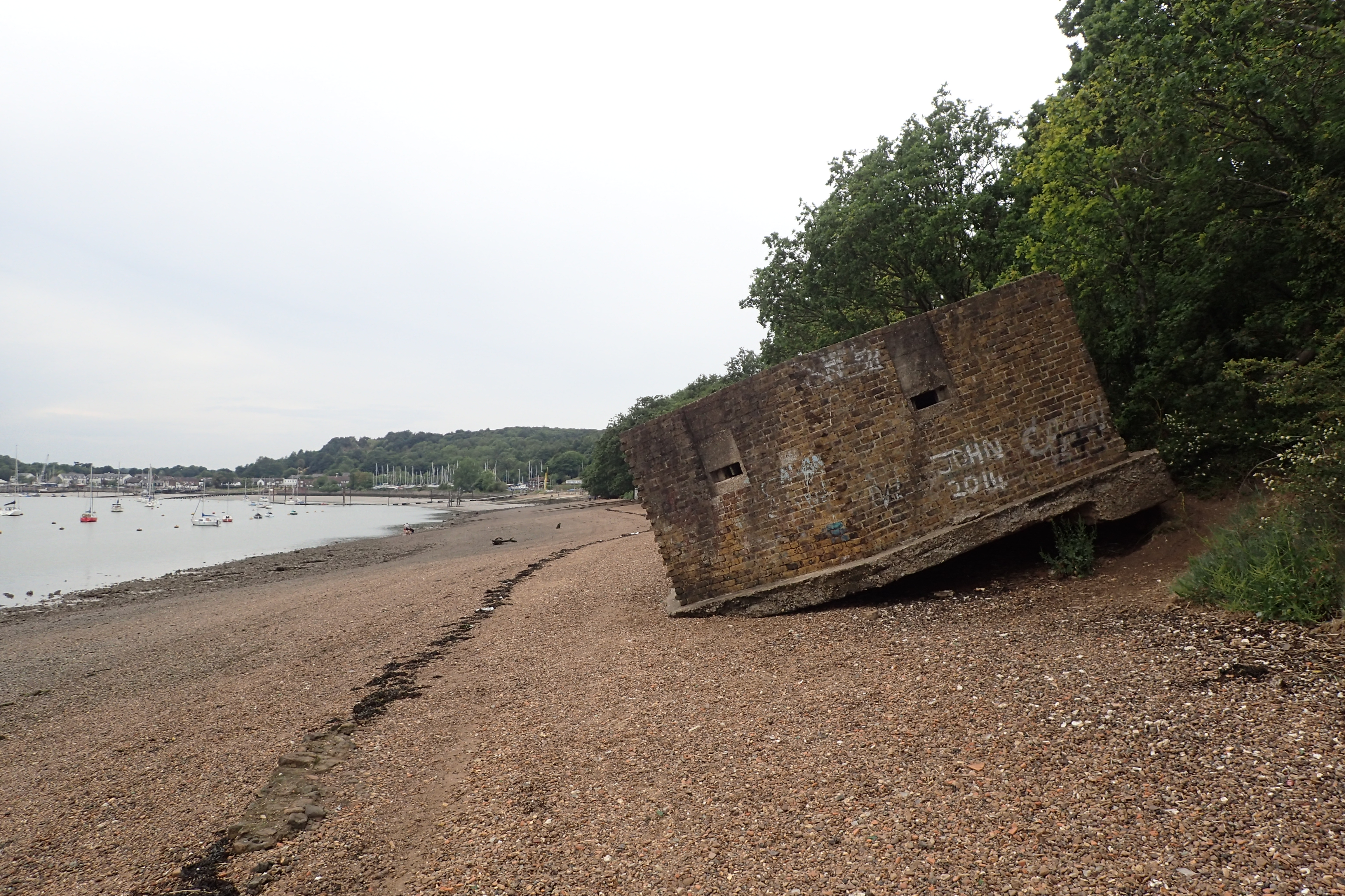 Following the shore approaching Medway, the Saxon Shore Way passes a second World War pillbox that has been undercut by the River Medway