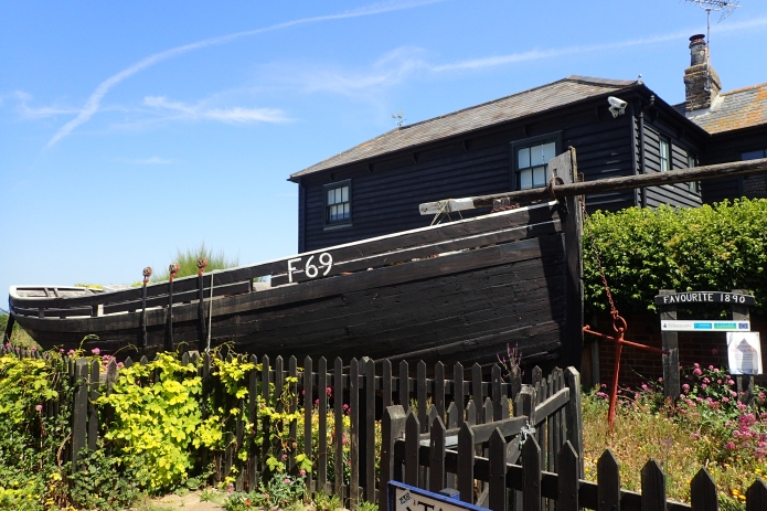 Favourite is the last surviving oyster yawl in Whistable. Built in 1890, her working life ended when shot at by a German fighter in 1944. She now sits in a garden besdie the Saxon Shore Way