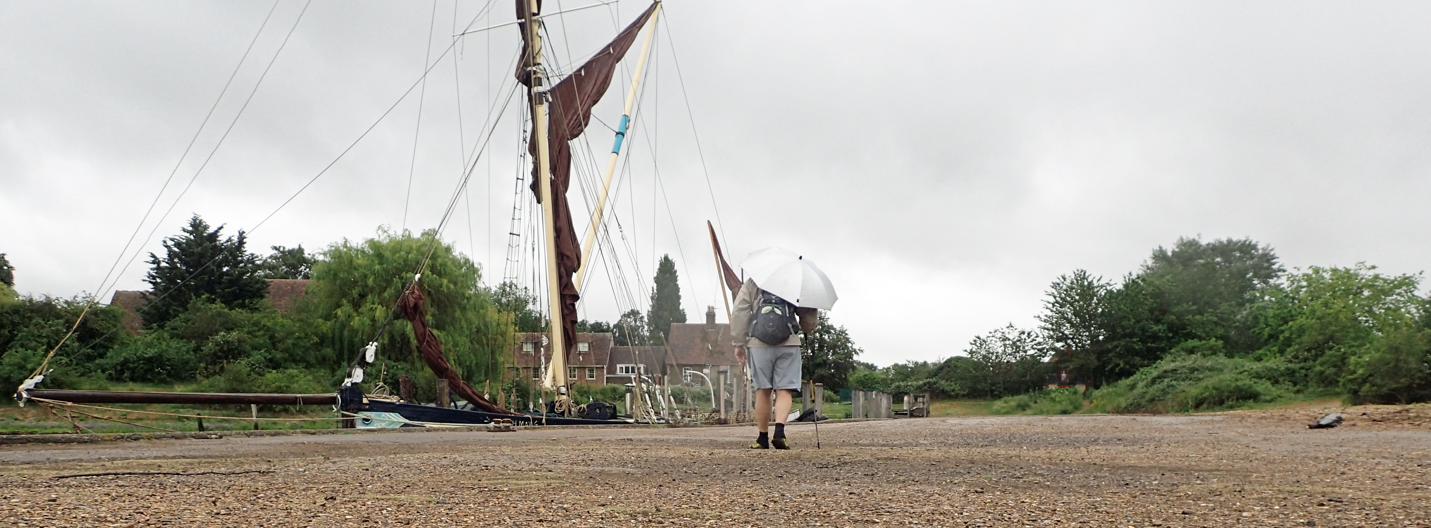 Passing the Edith May moored at the empty dock at Lower Halstow, rain fell steadily