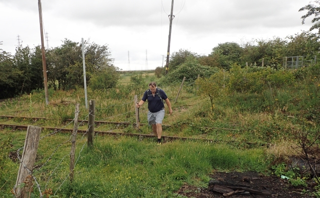 Crossing a long unused railway line crossing fields on a little visited section of the Saxon Shore Way- day three, approaching Sittingbourne