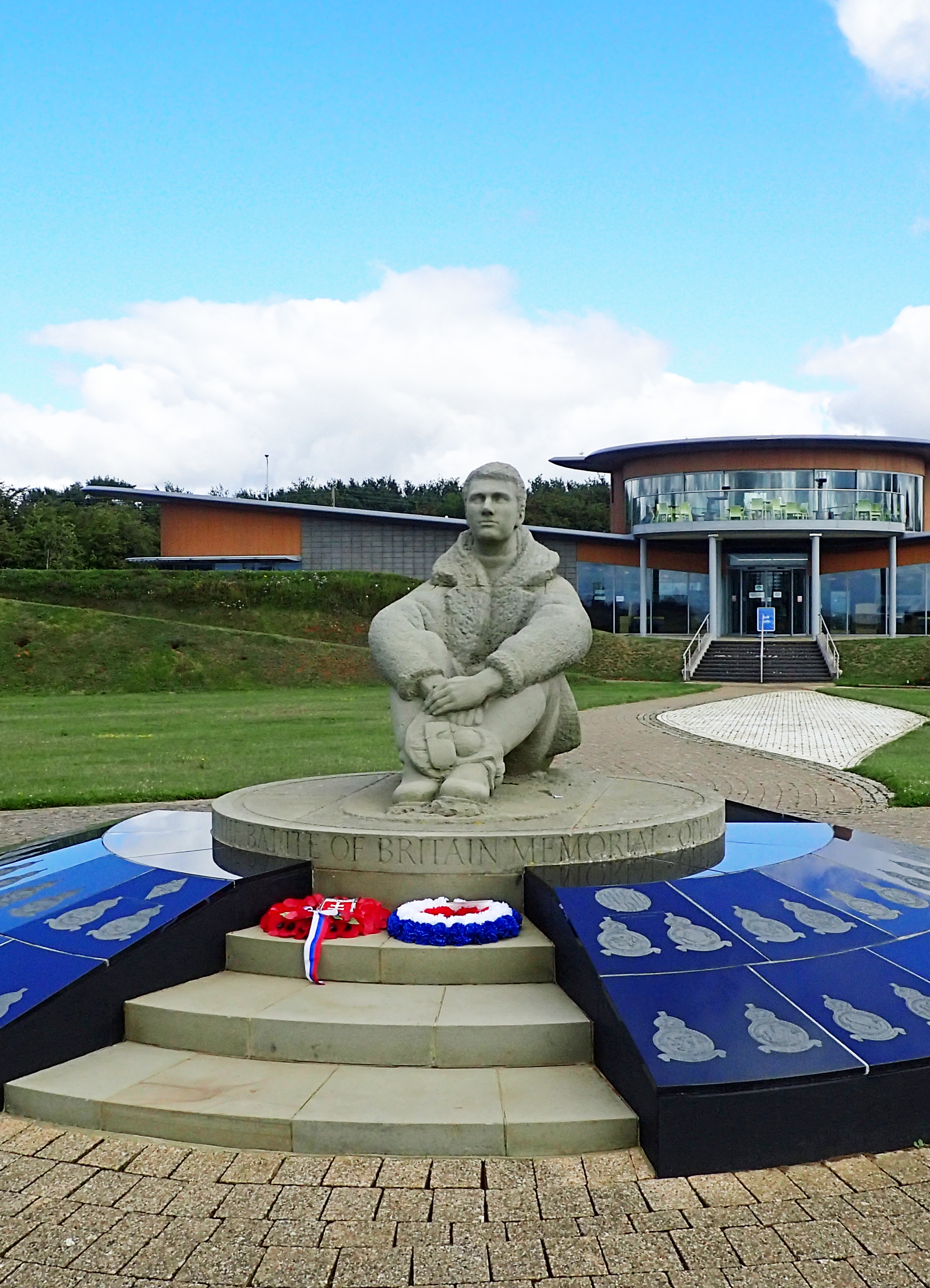 Statue of seated RAF pilot at Battle of Britian Memorial