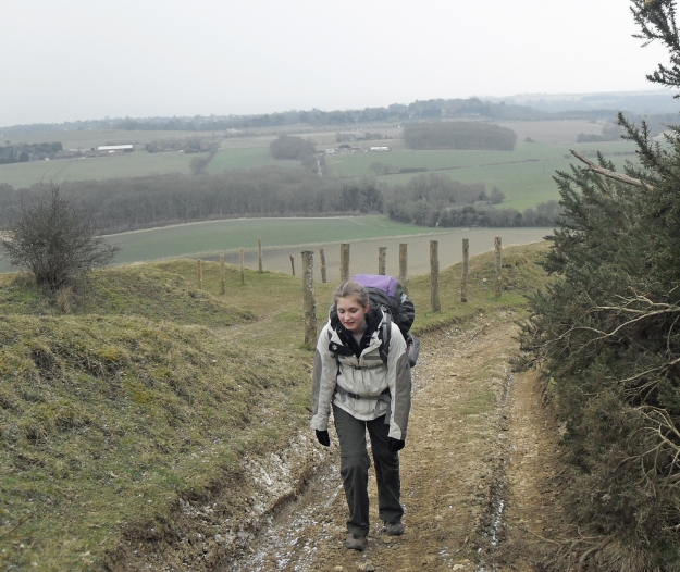 Miss Three Points of the Way climbing Tolsford Hill when completing the Elham Valley Way in 2013. The Saxon Shore Way decends this hill toward Sandling