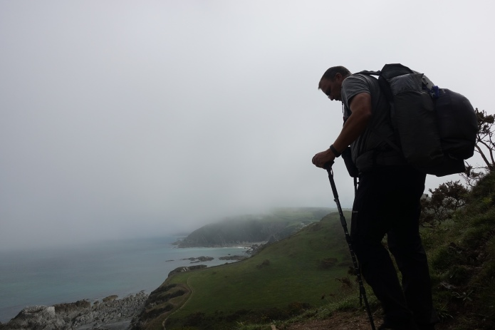 Chest pouch being used to carry items required to hand on the South West Coast Path. Hat and waterproofs are stuffed into the packs stretchy rear pocket
