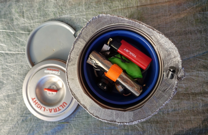 Evernew 900ml pan with GSI mug. Inside these is the collapsed and coiled Kovea Spider, butane gas canister adapter, titanium foil windscreen, torjet lighter and even a spare gas stove- the BRS 3000-T