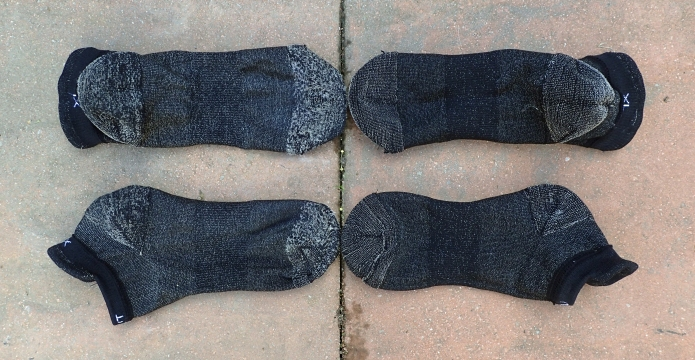 Silverlight socks on the left have completed over one hundred trai miles, compared with new pair on right. All socks are turned inside out