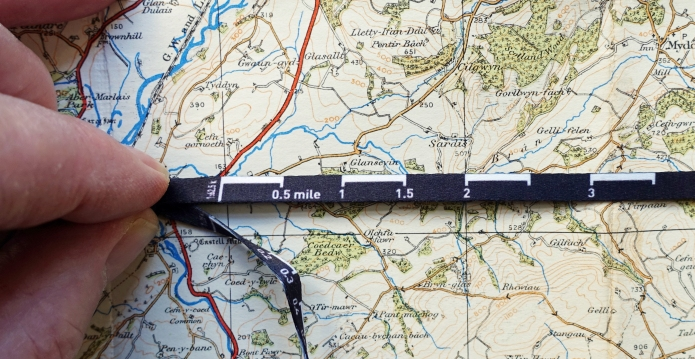 Silva measuring lanyard on 1 inch to 1 mile scale map
