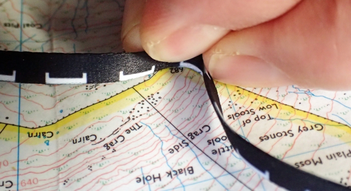The Silva lanyard measure works best when used on edge to track curves and bends on a map
