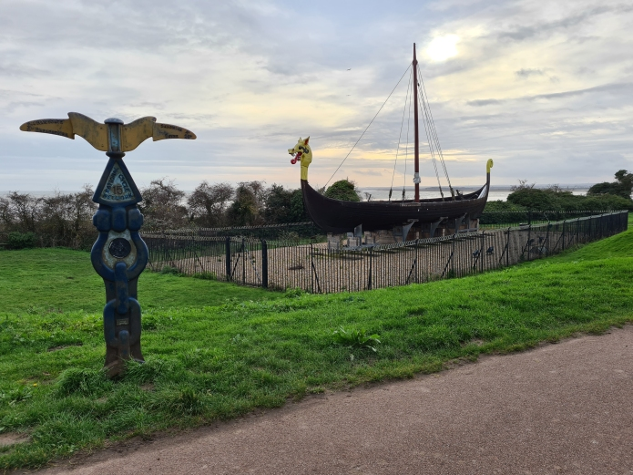 Sustrans Millennium Milepost beside the Hugin- a replica Viking longship sailed from Denmark to Viking Bay, Broadstairs