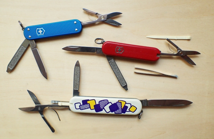 Victorinox Classic SD with three main folding tools and two scale tools open and exposed. Together with the Alox Classic SD, that has no scale tools, and the slightly larger Victorinox Ambassador, that has the same tools as the Classic, but larger