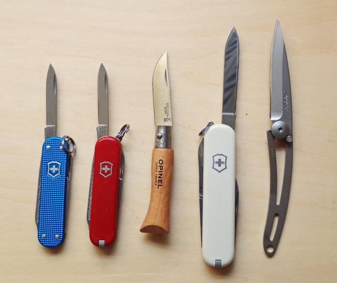 Blades compared- Victorinox Classic SD, Victorinox Classic SD, Opinel No. 3, Victorinox Ambassador, Deejo 15g