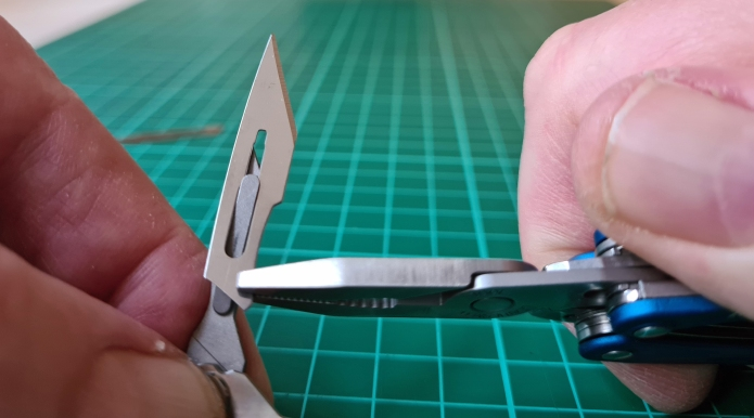 Using pliers on Leatherman keychain multi-tool to change blade on NTK05