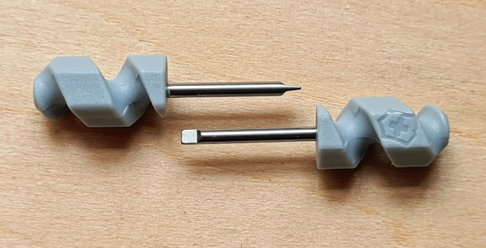 Old and new versions of the mini flat tip screwdriver from Victorinox. The new tools now include the Victorinox logo
