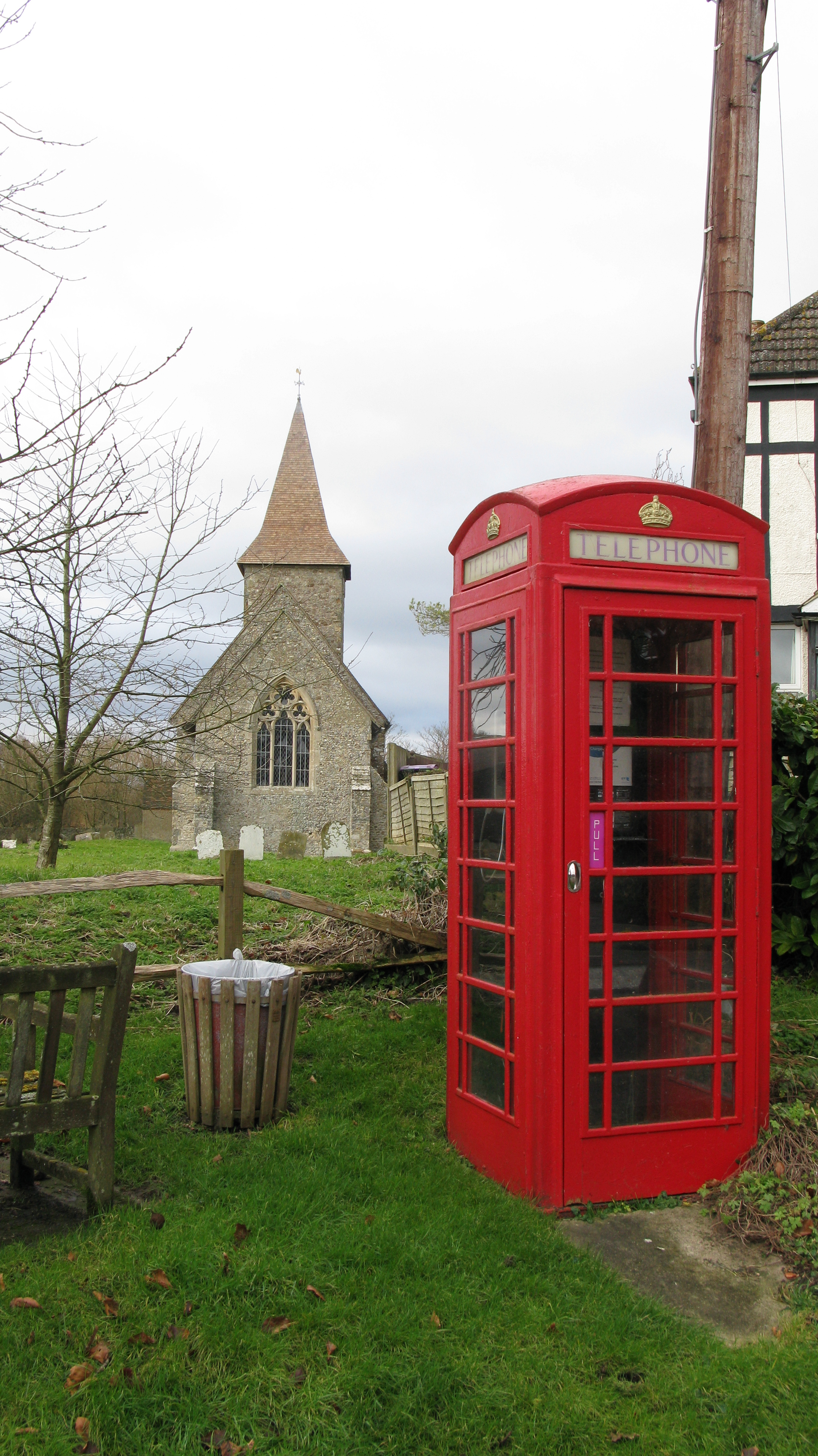 K6 kiosk in front of the Saxon church of St. Mary and St. Radigund. North Downs Way