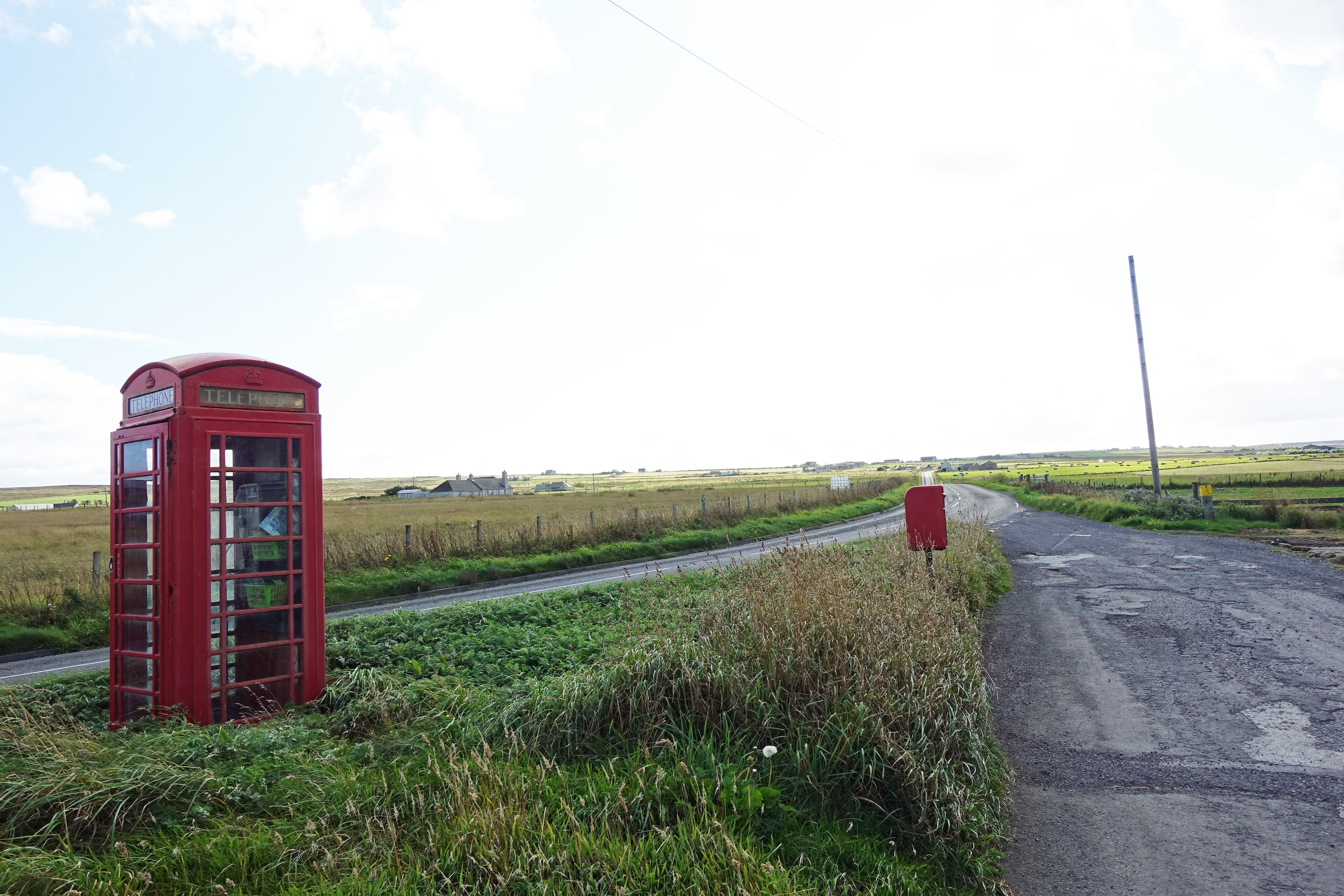 K6 kiosk on the road approaching John O'Groats. In the roll-out years of mobile phones in the UK, coverage could sometimes be patchy in lonely areas. Landlines were crucial for many years, less so  today