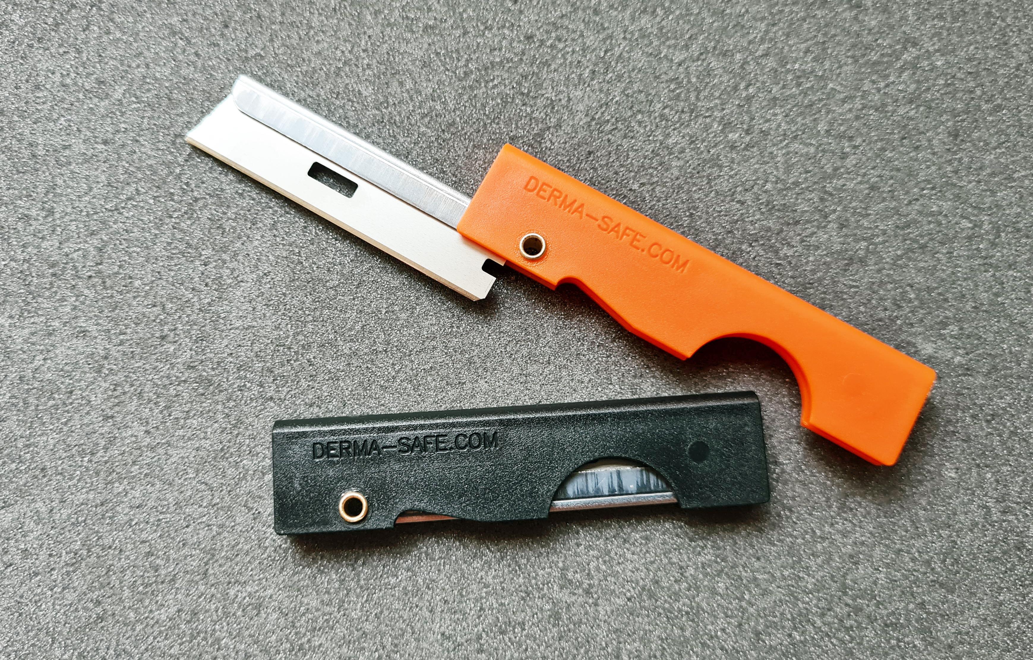 Black and orange handled Derma-Safe razors