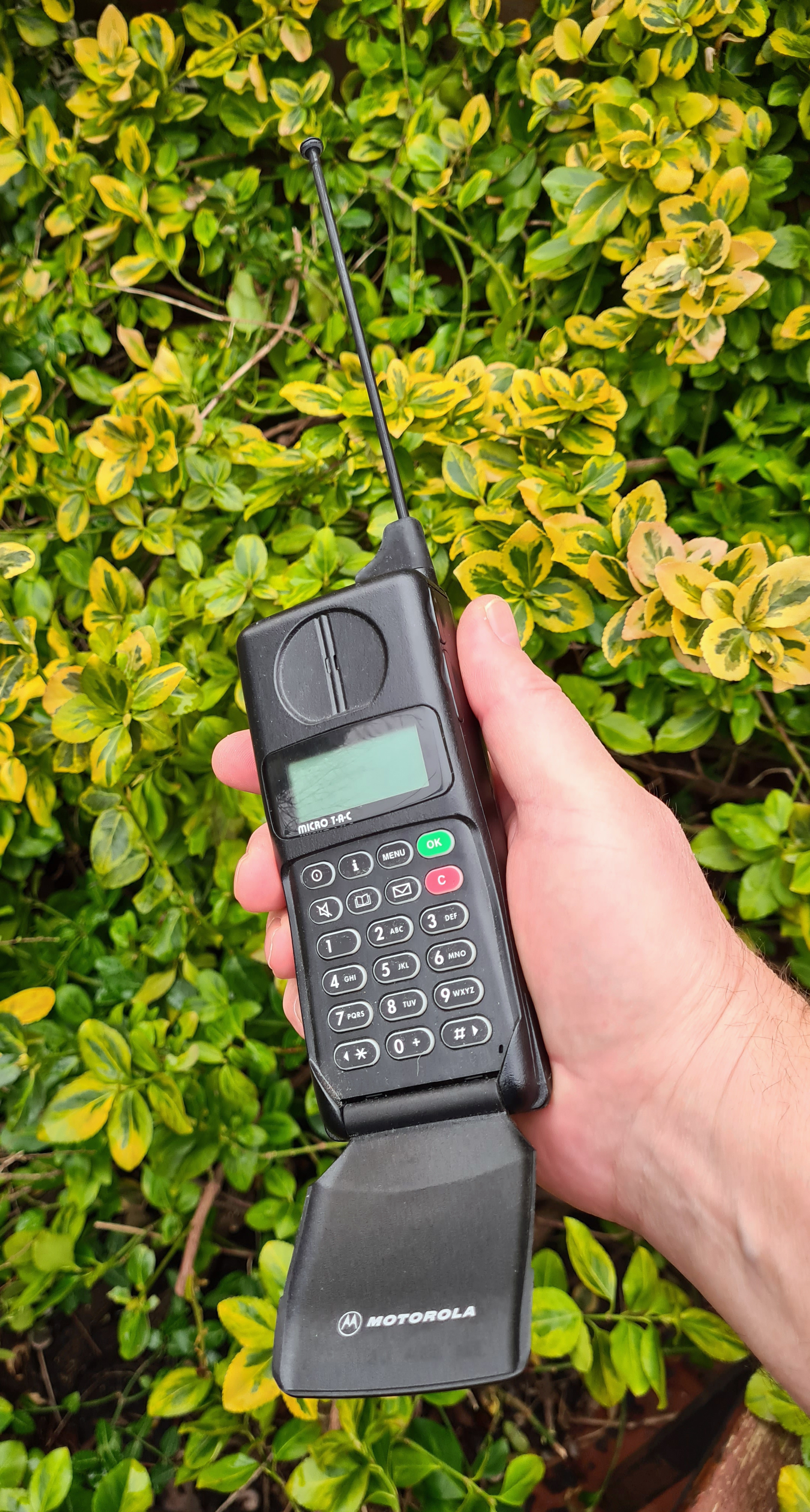 Motorola International 7500 GSM 900 'flip phone' from 1995. With extending ariel and a flip open cover over the keys. The MicroTAC was a digital phone that evolved out of an analogue phone. This 'brick' had been left behind when Nokia shot ahead with adopting the emerging GSM standard