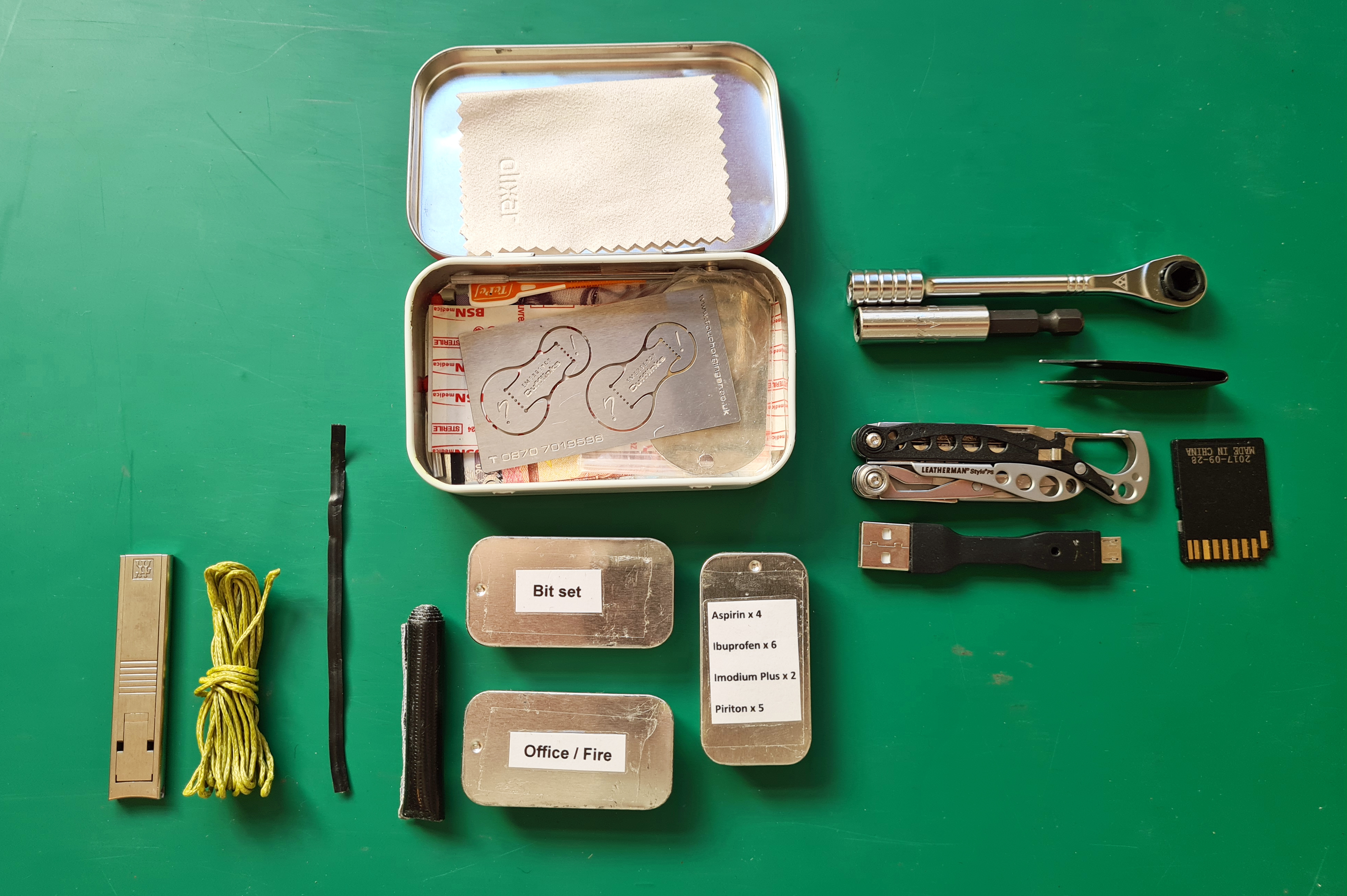 Urban Altoids tin with first, second and third layers removed