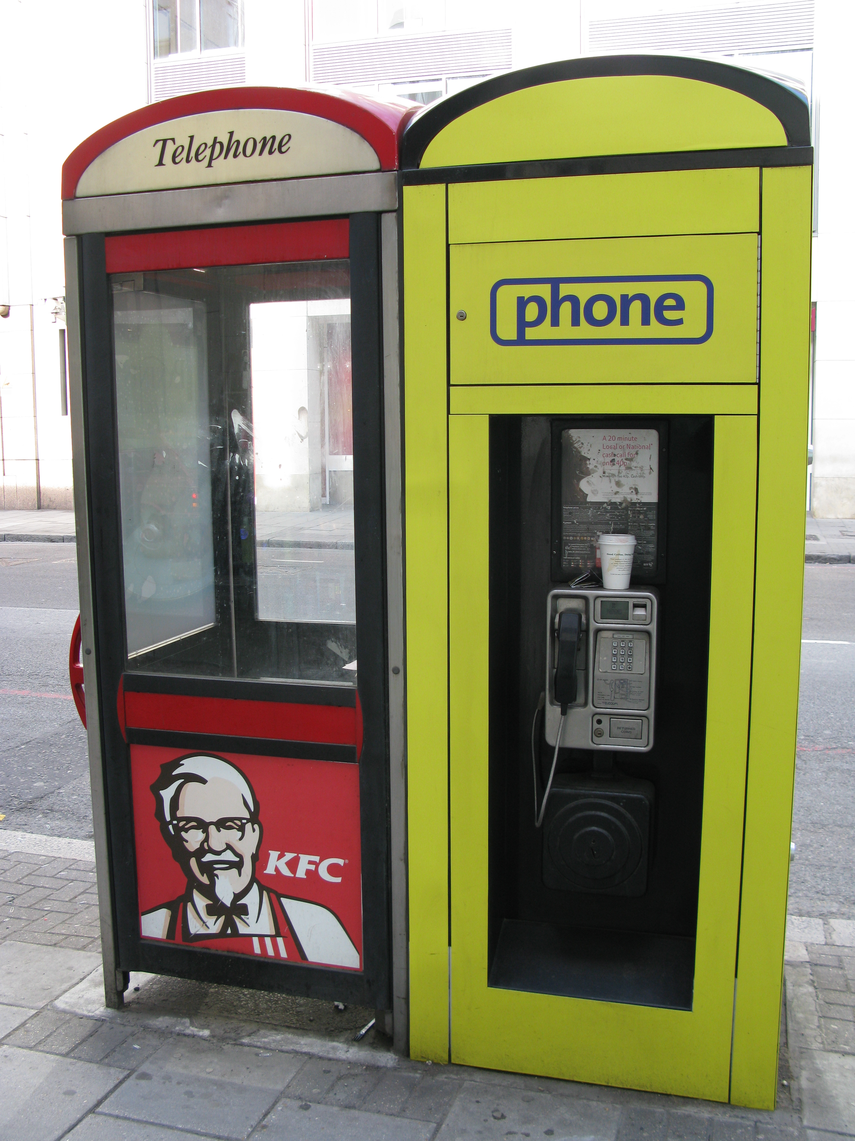 British Telecom KX100 Plus kiosk, with added cowling to mimic that of a K series kiosk, and competitor kiosk beside