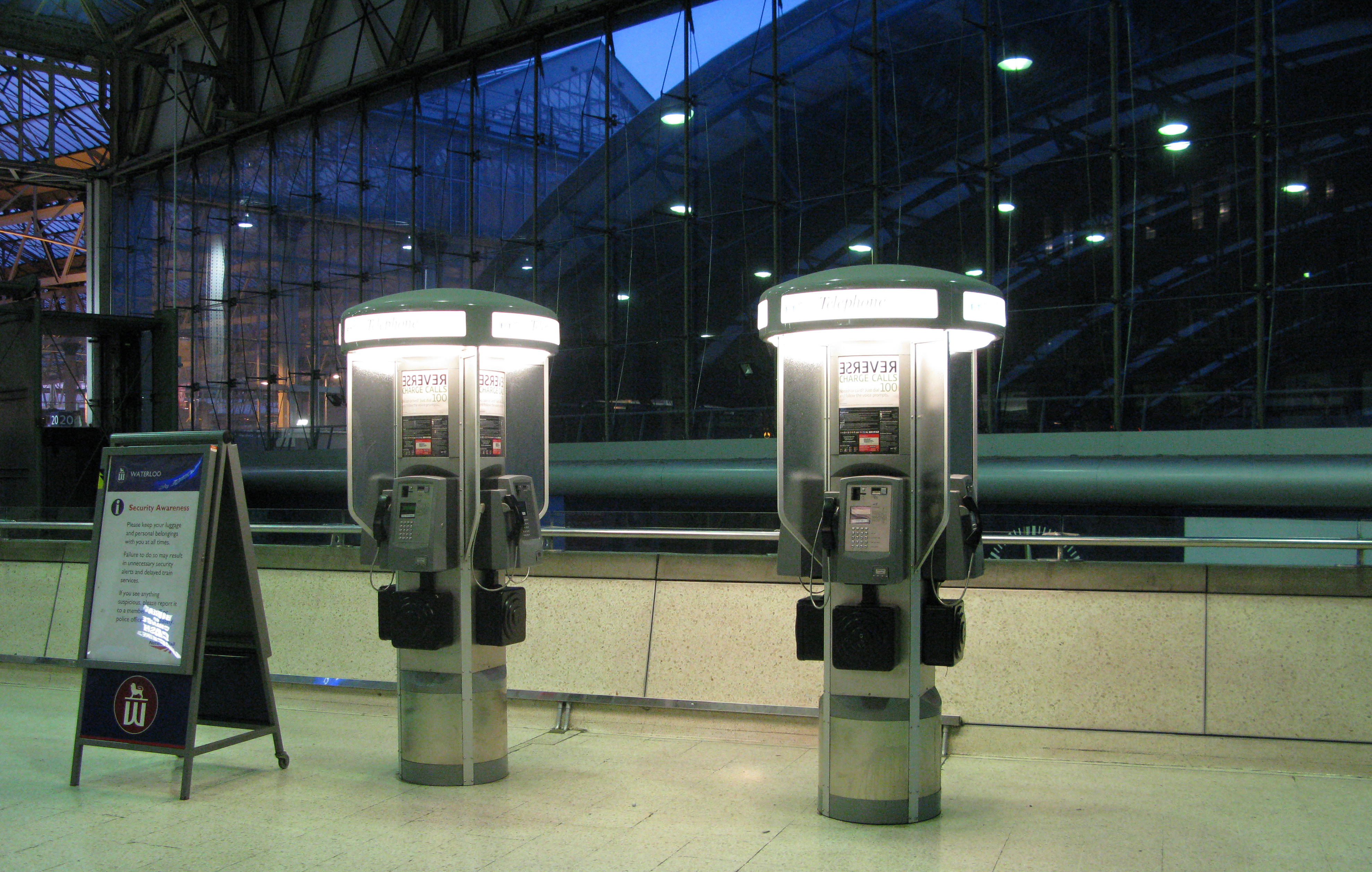 Four-sided pedestal BT phone booths at Waterllo railway station