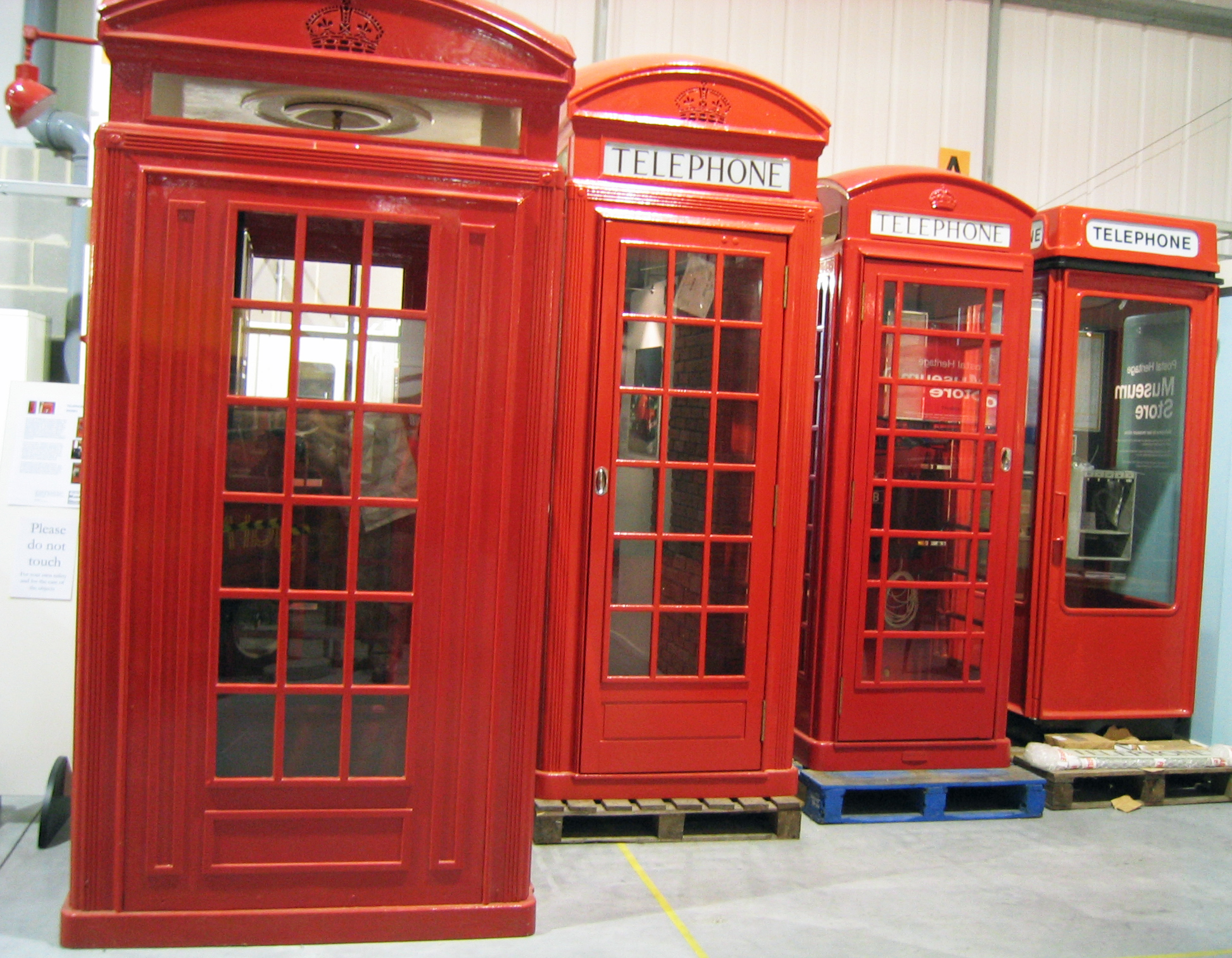Probably the only time you will see a photo of the four classic K series of red-painted kiosks directly compared side-by-side. Photographed at the Postal Museum's store, from left to right- K4, K2, K6 and K8