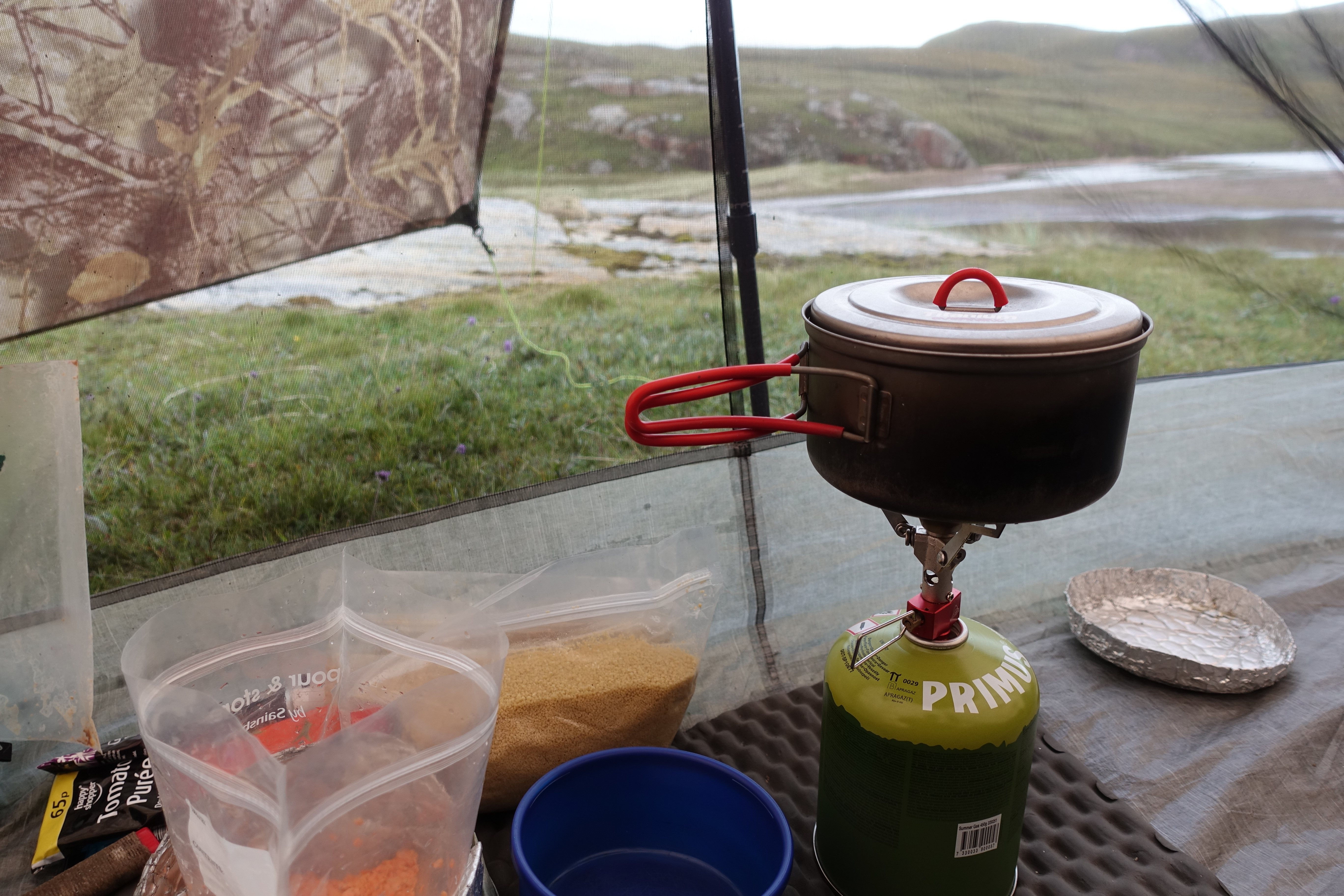 Cooking inside Z Packs Duplex on the penultimate night on the Cape Wrath Trail. Midges have driven me inside and a sit mat has provided a flat stable floor on which to set up a stove