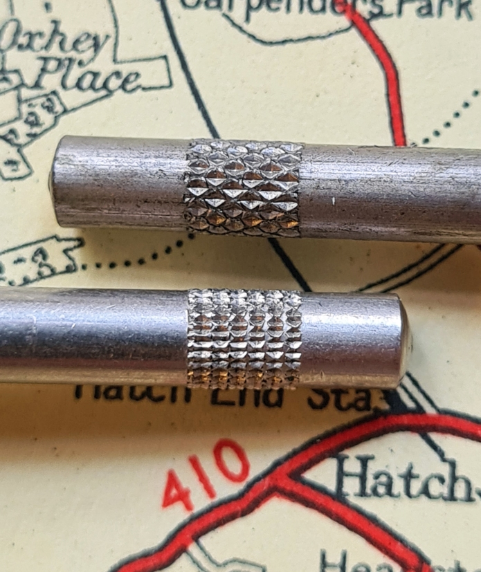 Some differences in the manufacture of the Universal measure are very small indeed, such as a change in the knurling on the handle