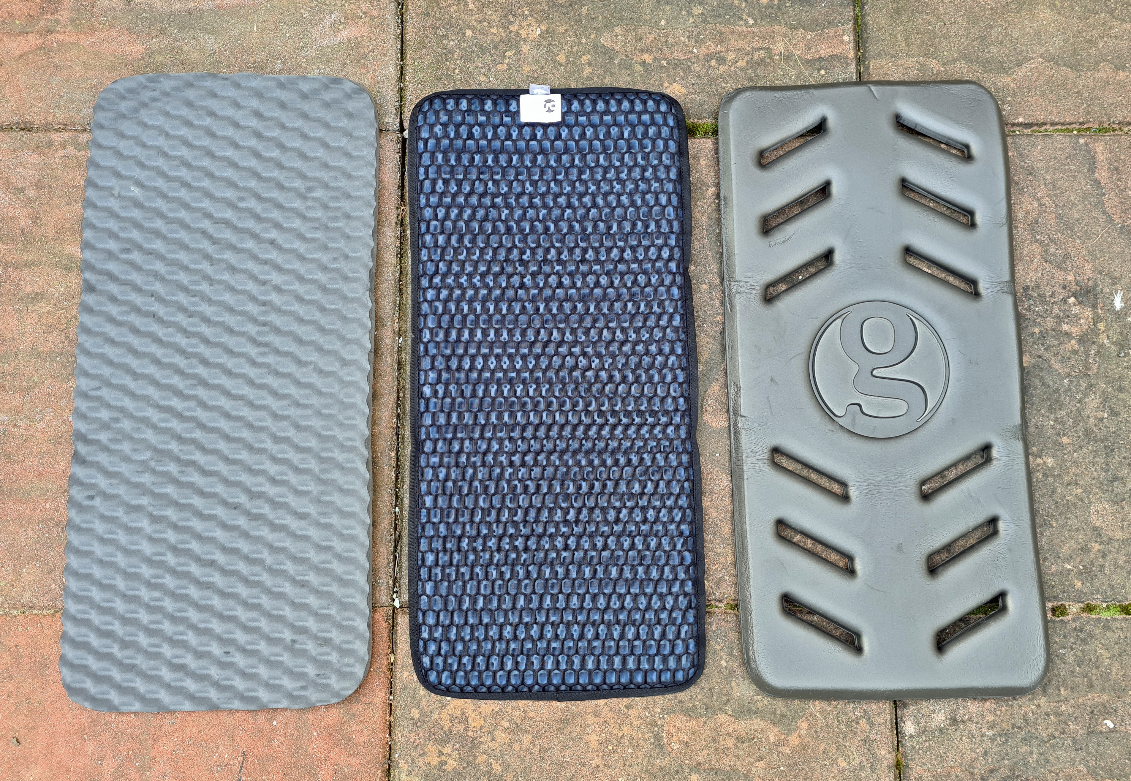 Front face of three Gossamer Gear sit pads compared