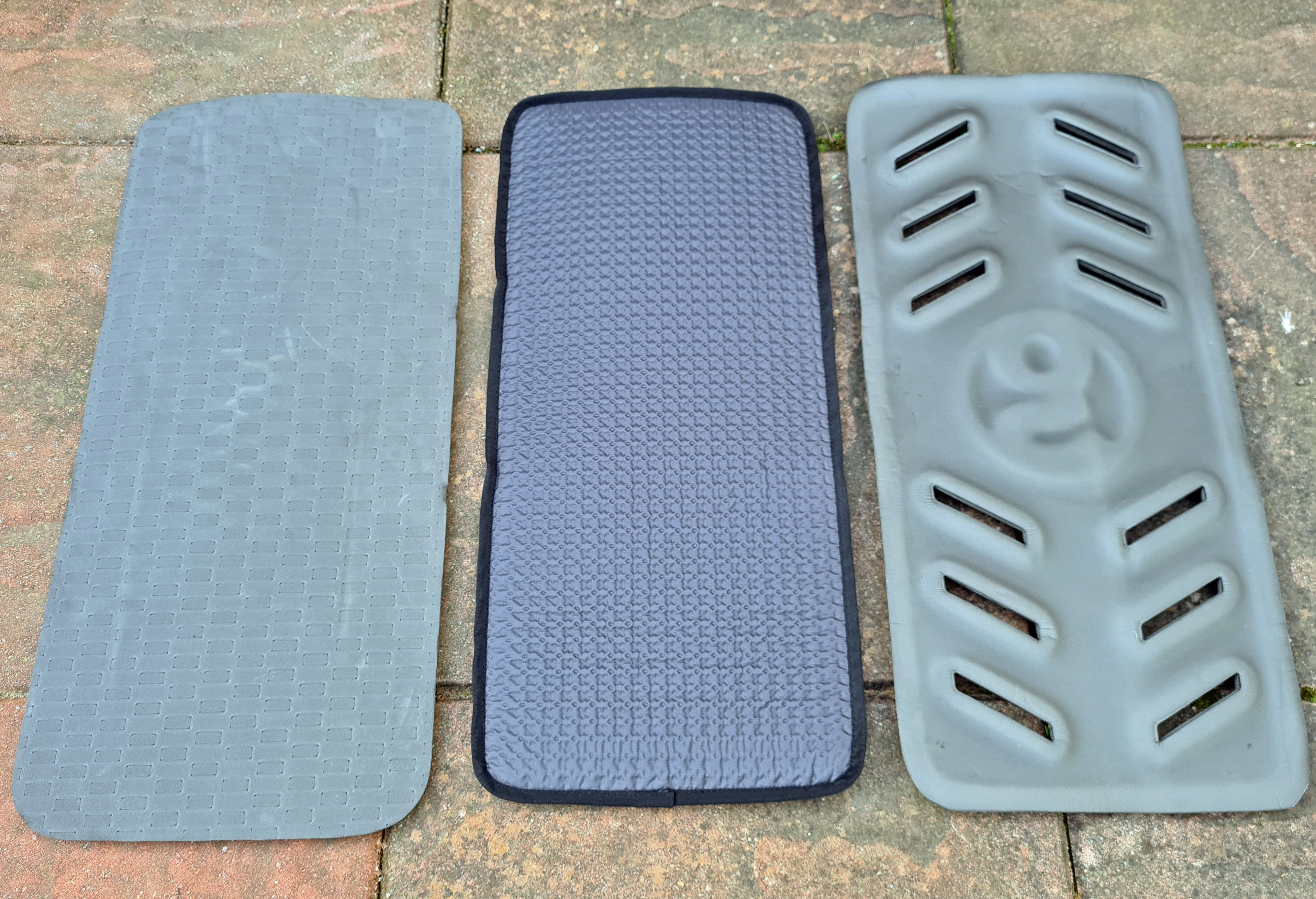 Reverse of three Gossamer Gear sit pads compared