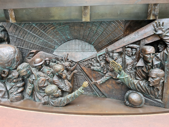 Detail from bronze relief frieze of The Meeting Place