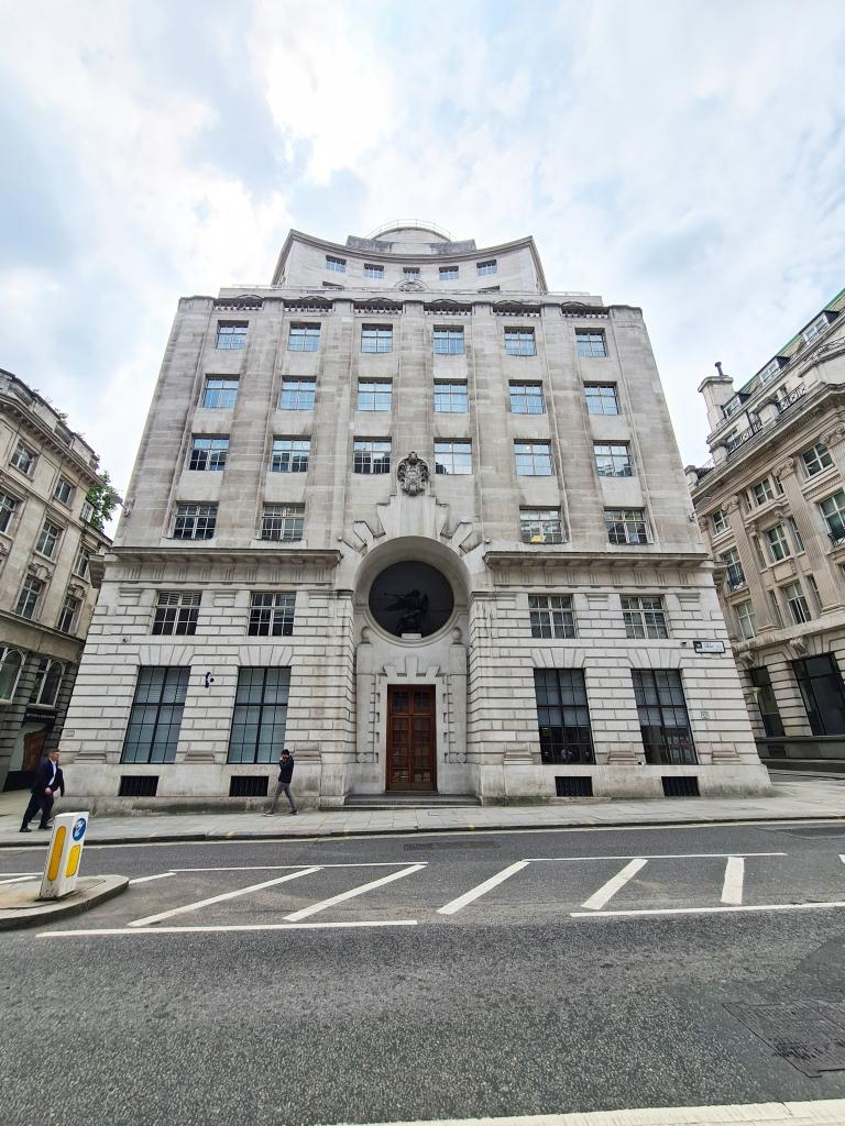 85 Fleet Street, former Reuters Building. Statue of Fame above entrance