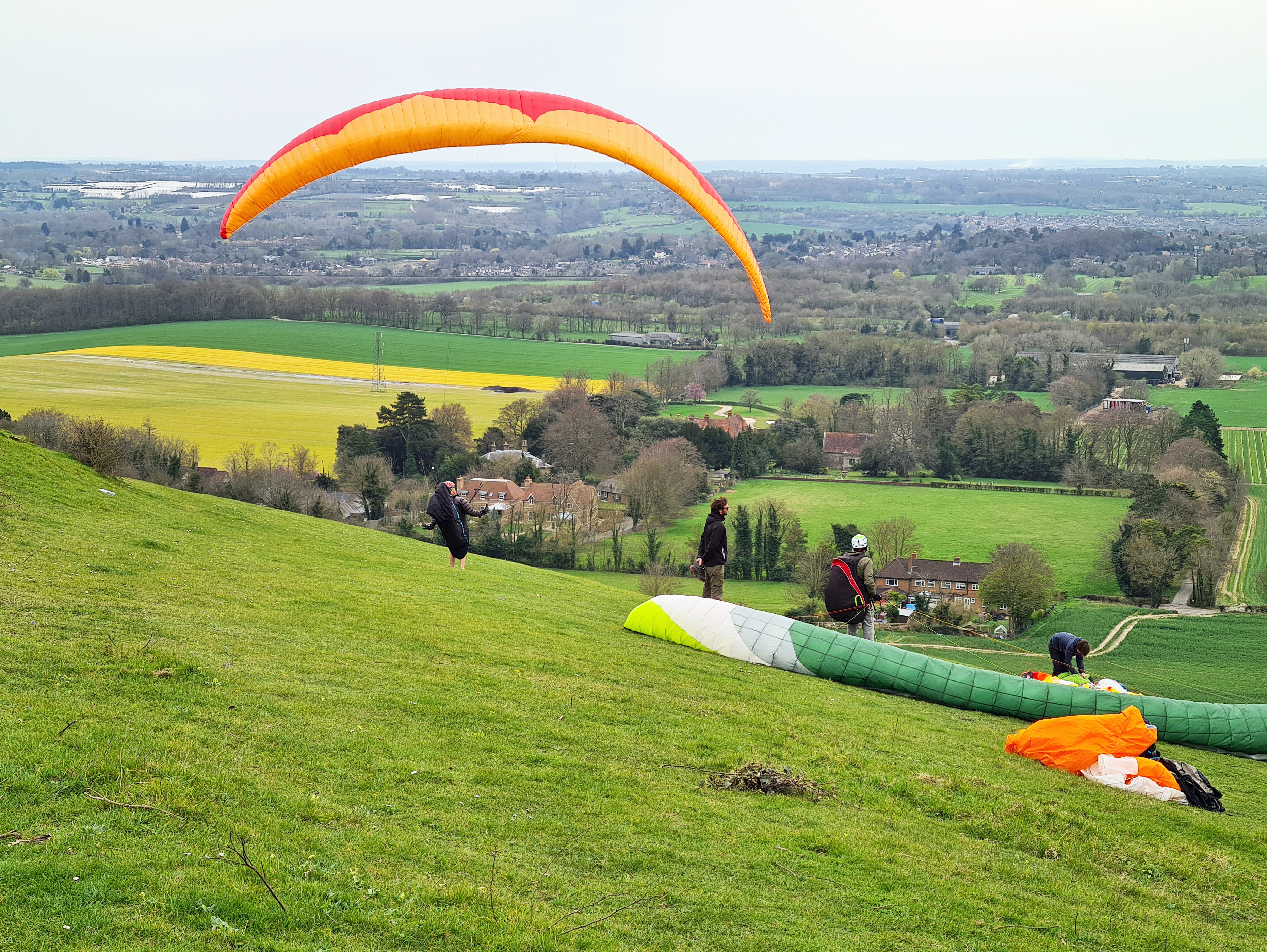 Paragliders on the North Downs Way above Thurnham
