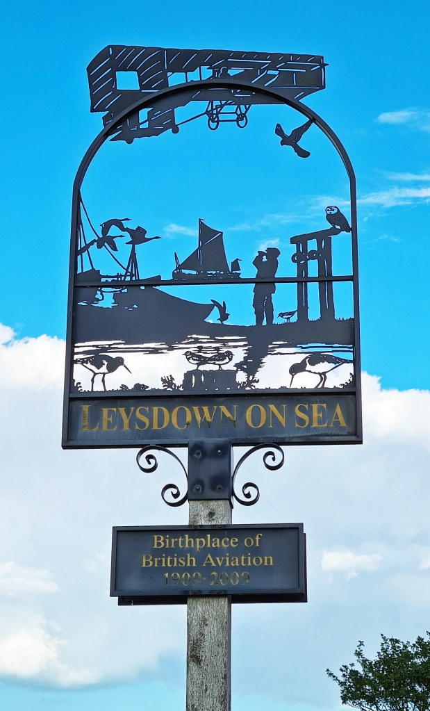 Pierced metal sign at Leysdown on Sea shows not only local wildlife but focuses on its place in aviation history