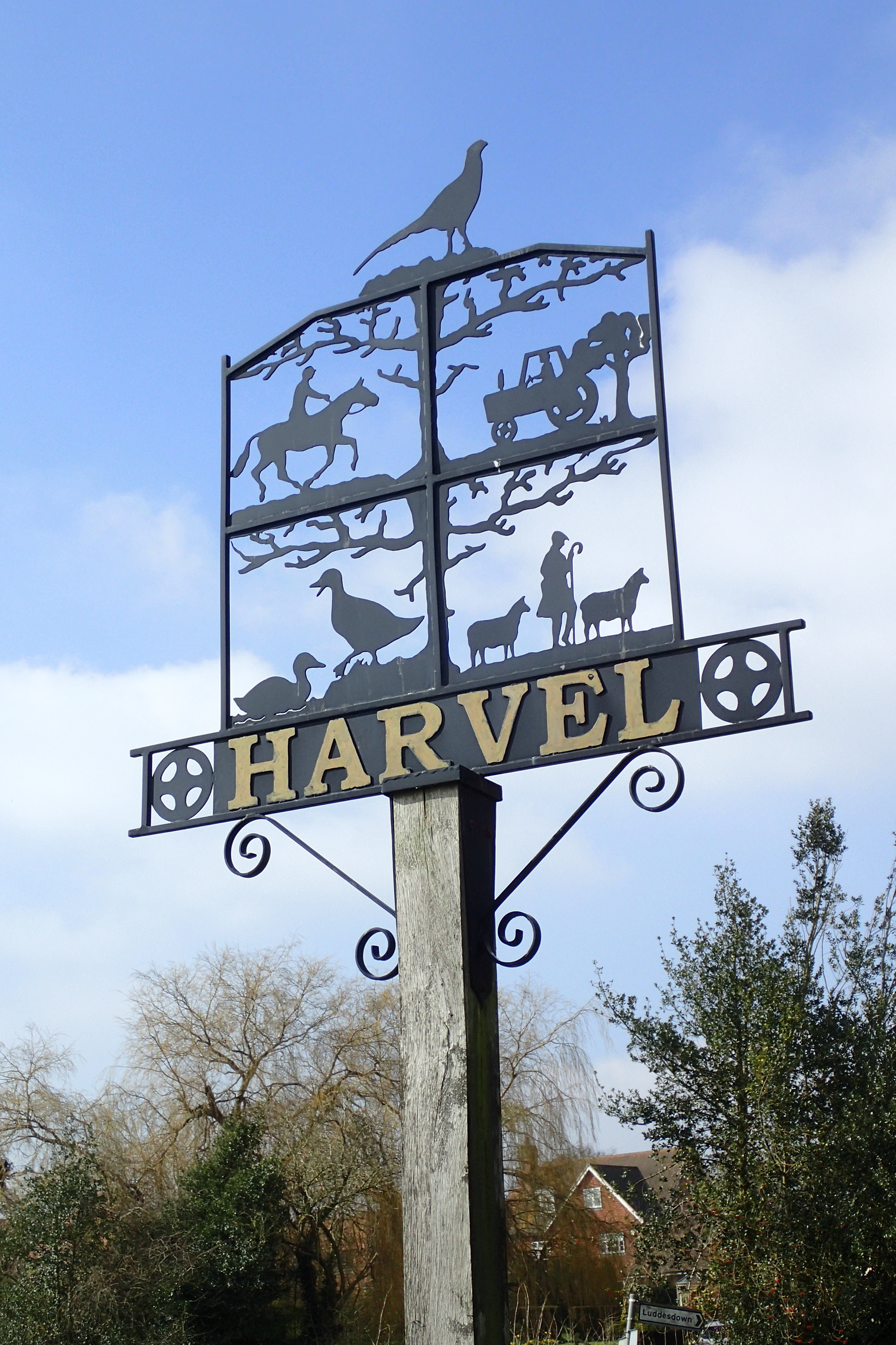 Perforated metal village sign at Harvel