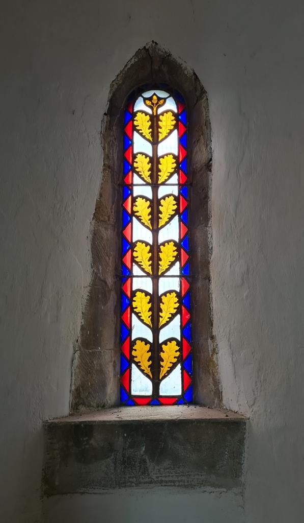 Small Norman window, c1100, lets in little light